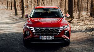 Preview wallpaper hyundai, car, suv, red, road, forest