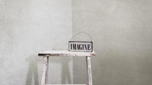 Preview wallpaper imagination, word, inscription, chair, white