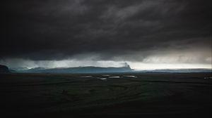Preview wallpaper island, dark, clouds, iceland