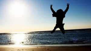 Preview wallpaper joy, happiness, people, jump, sky, sea, beach