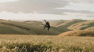 Preview wallpaper jump, levitation, silhouette, field, hills