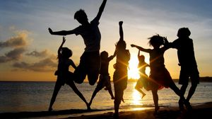 Preview wallpaper jump, people, happiness, light, sunset