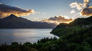 Preview wallpaper lake, sunset, trees, mountains, lake wakatipu, new zealand