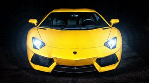 Preview wallpaper lamborghini, yellow, sports car, headlight, front view