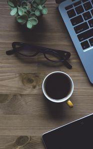 Preview wallpaper laptop, cup, glasses, plant