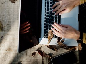 Preview wallpaper laptop, hands, work, leaves, autumn, aesthetics