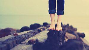 Preview wallpaper legs, jeans, girl, rocks