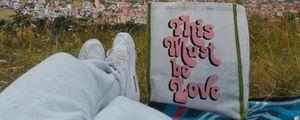 Preview wallpaper legs, sneakers, bag, words, city, buildings