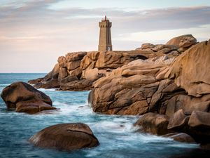 Preview wallpaper lighthouse, building, rocks, coast, stones, sea