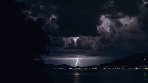 Preview wallpaper lightning, night, overcast, clouds, river