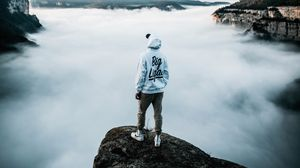 Preview wallpaper lonely, loneliness, cap, sneakers, fog