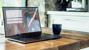 Preview wallpaper macbook, laptop, cup, table, room