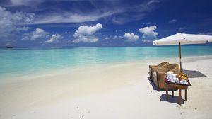 Preview wallpaper maldives, ocean, beach, sand, water, clouds, umbrella