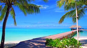 Preview wallpaper maldives, sky, clouds, island, palm trees, bungalows, sea, ocean