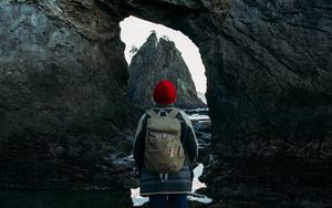 Preview wallpaper man, alone, rocks, arch, nature