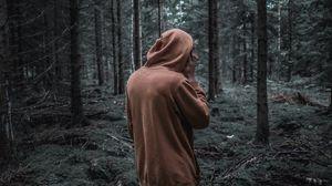 Preview wallpaper man, forest, hoodie, walk