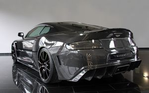 Preview wallpaper mansory, aston martin, dbs, 2009, carbon, black, rear view, style, reflected