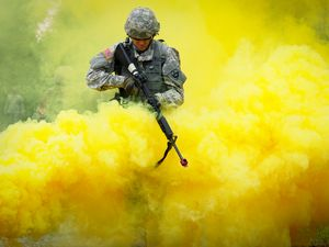 Preview wallpaper military, camouflage, weapon, rifle, smoke, yellow