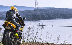 Preview wallpaper motorcycle, motorcyclist, biker, bike, moto, yellow
