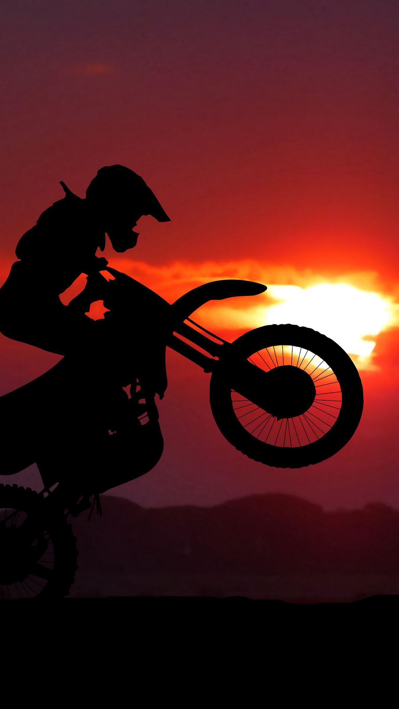 1350x2400 Wallpaper motorcycle, motorcyclist, cross, stunt, silhouette, sunset