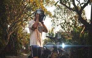 Preview wallpaper motorcycle, motorcyclist, helmet, bike, gray