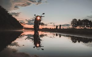 Preview wallpaper motorcycle, sunset, reflection, water, sky