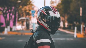 Preview wallpaper motorcyclist, helmet, jacket, backpack, blur