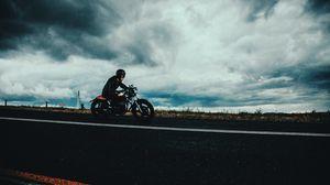 Preview wallpaper motorcyclist, road, marking, asphalt, helmet, clouds, overcast