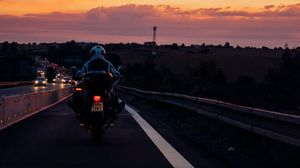 Preview wallpaper motorcyclist, sunset, sky, clouds, road, marking