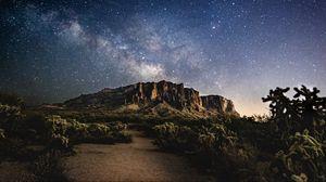 Preview wallpaper mountain, night, stars, starry sky, dark, landscape