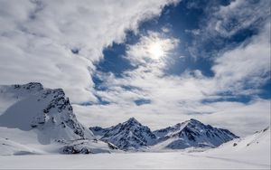 Preview wallpaper mountains, snow, winter, clouds, sky, rays, sun