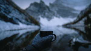 Preview wallpaper mug, hand, glove, nature, mountains