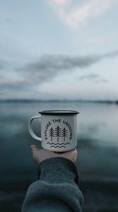 Preview wallpaper mug, inscription, hand, lake, nature