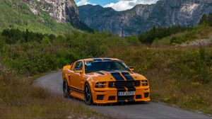 Preview wallpaper mustang shelby, car, muscle car, orange, road, mountains