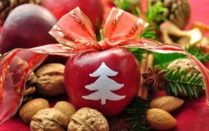 Preview wallpaper new year, holiday, table, apples, ribbon, bow, decoration, walnuts, pine needles, pine cones, cinnamon