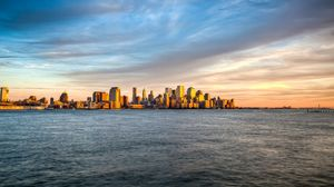 Preview wallpaper new york, manhattan, island, sea, waves, water, landscape, view, review, sky, evening, sunset, clouds