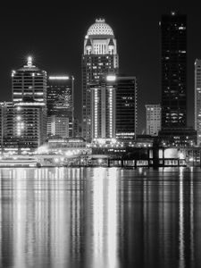 Preview wallpaper night city, city, buildings, lights, water, reflection, black and white