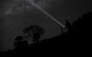 Preview wallpaper night, starry sky, man, flashlight, glow