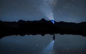Preview wallpaper night, starry sky, silhouette, flashlight, beam, darkness