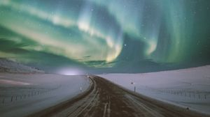 Preview wallpaper northern lights, aurora, road, snow, starry sky