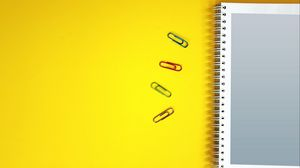 Preview wallpaper notebook, paper clips, surface, yellow