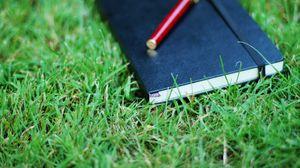 Preview wallpaper notebook, pen, grass, herbs