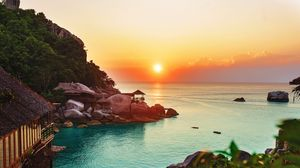 Preview wallpaper ocean, horizon, sunset, beach, vegetation