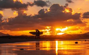 Preview wallpaper ocean, silhouettes, surfing, surfers, sunset