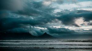 Preview wallpaper ocean, surf, rocks, clouds, overcast, storm