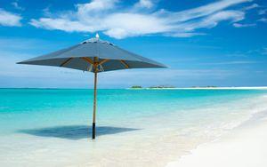 Preview wallpaper ocean, umbrella, horizon, clouds, tropics, shore
