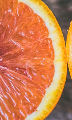 240x400 Wallpaper orange, citrus, cut, ripe
