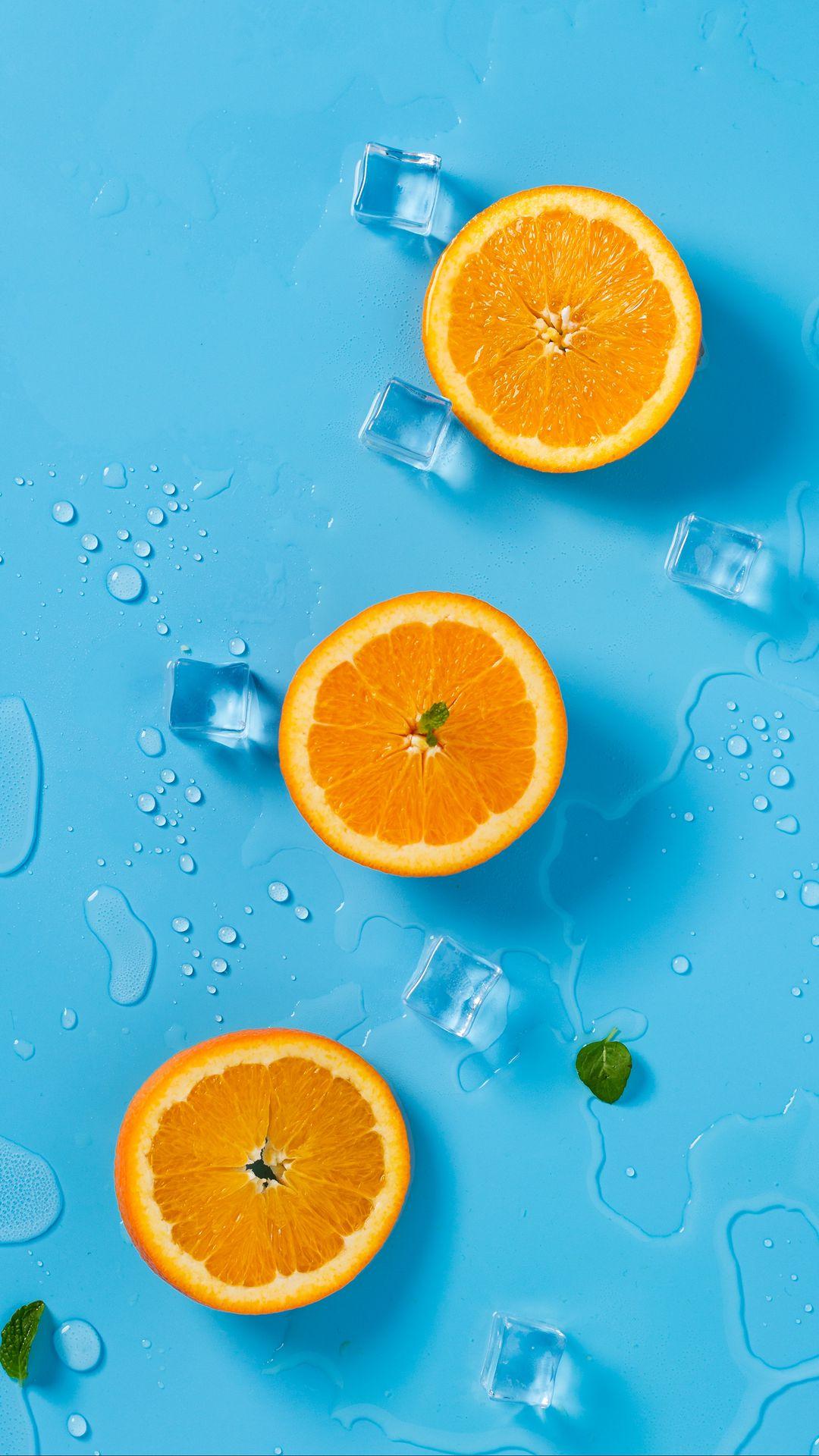 1080x1920 Wallpaper orange, ice, mint, citrus, rings, melting