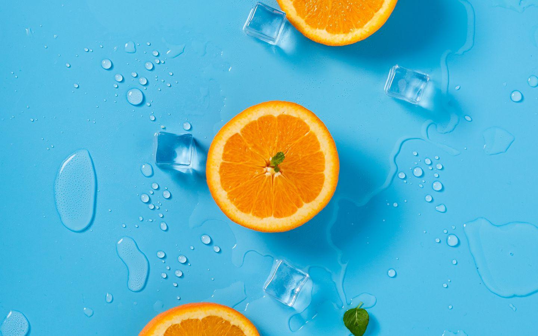 1440x900 Wallpaper orange, ice, mint, citrus, rings, melting