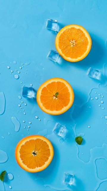 360x640 Wallpaper orange, ice, mint, citrus, rings, melting